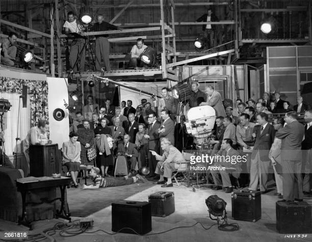 The technicians craftsmen and studio personnel the small army of workers behind the scenes during the filming of MGM's 'The Next Voice You Hear'