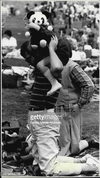 The Teddy Bears Picnic at Wentworth Park Sunday in Aid Childrens Hospital CamperdownAnthea Freshwater on her fathers shoulder Terry both of Taren...