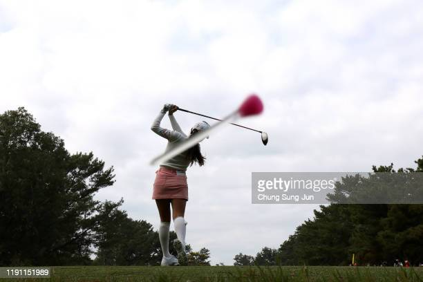 The tee of Bo-Mee Lee of South Korea hits the camera while her tee shot on the 4th hole during the final round of the LPGA Tour Championship Ricoh...