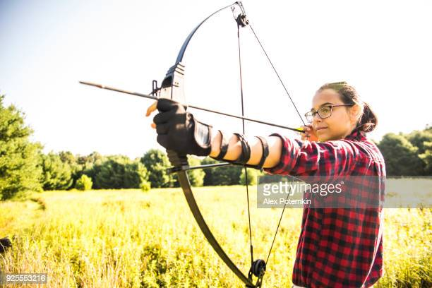 The teenager girl practicing archery