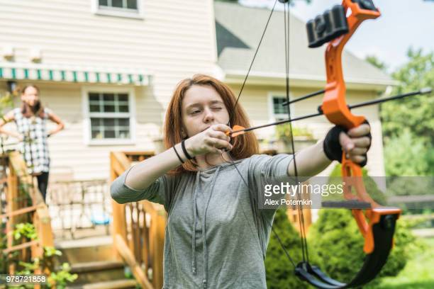 the teenager girl practicing archery - alex potemkin or krakozawr stock pictures, royalty-free photos & images