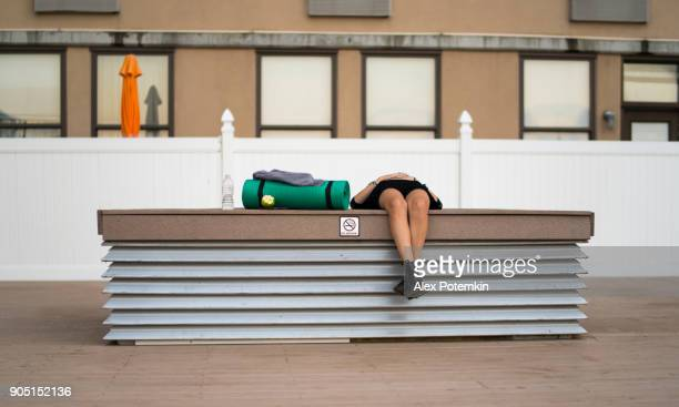 the teenager girl sleeping on the rooftop - alex potemkin or krakozawr stock pictures, royalty-free photos & images