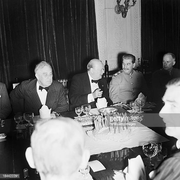 The Tehran Conference 28 November 1 December 1943 Winston Churchill with President Roosevelt and Marshal Stalin at a dinner party at the British...