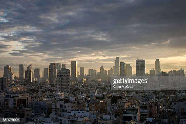 The Tel Aviv skyline is seen at sunrise on January 15, 2017 in Tel Aviv, Israel. 70 countries attended the recent Paris Peace Summit and called on...
