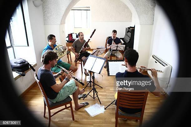 The Tel Aviv Wind Quintet Roy Amotz flute Yigal Kaminka oboe Danny Erdman clarinet Nadav Cohen bassoon and Itamar Leshem horn play in rehearsal at...