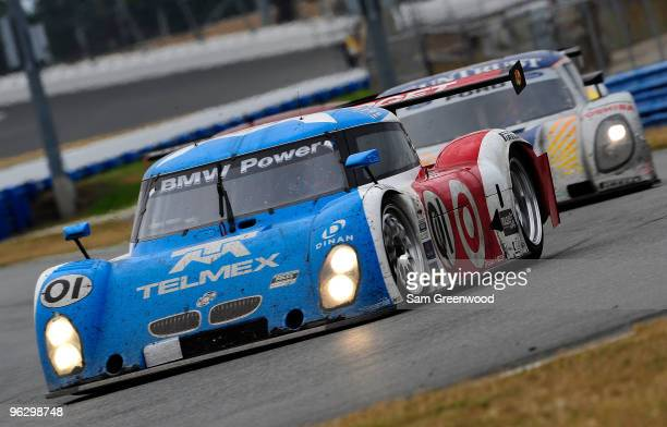 The TELEMEX/Target BMW Riley driven by Scott Pruett Memo Rojas Justin Wilson and Max Papis races during the GrandAm Rolex 24 at Daytona held at...