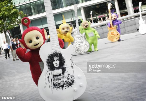 The Teletubbies play with the Guitars outside the GLA London to celebrate their 10th year on television
