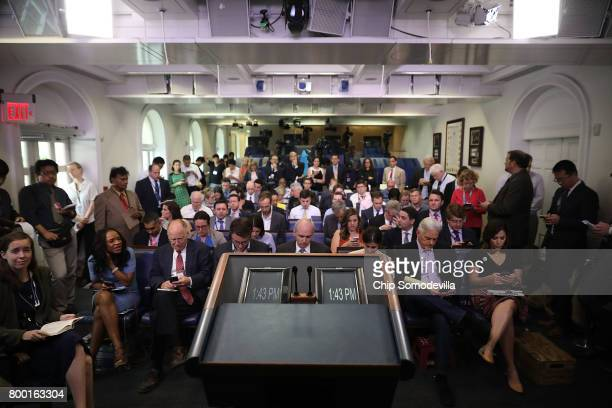 The television lights remain off as reporters wait for the arrival of White House Press Secretary Sean Spicer in the James Brady Press Briefing Room...