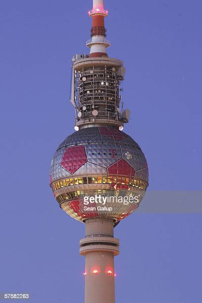 The television tower on Alexanderplatz with its sphere decorated like a giant soccer ball stands at twilight May 9 2006 in Berlin Germany Germany...