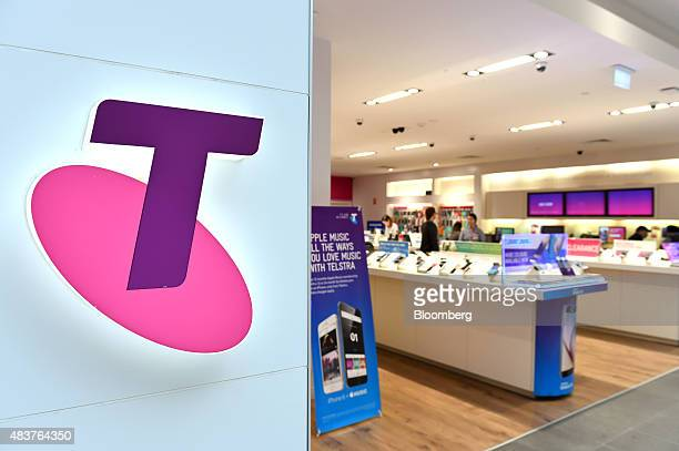 The Telstra Corp logo is displayed at a retail store in Melbourne Australia on Thursday Aug 13 2015 Telstra posted profit that met analysts'...