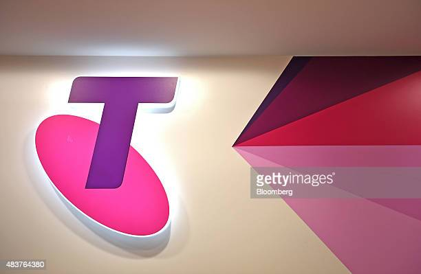 The Telstra Corp logo is displayed inside a retail store in Melbourne Australia on Thursday Aug 13 2015 Telstra posted profit that met analysts'...