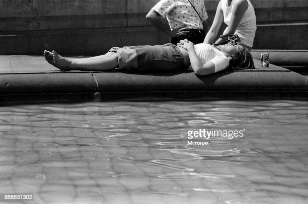 The temperatures rose again today in London and pavements became hotter and hotter A woman relaxes in the sunshine in Trafalgar Square 24th June 1976