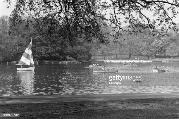 The temperatures rose into the upper 70's again today and crowds flocked to sunbathe and relax in Hyde Park London Rowers keep cool in the Serpentine...