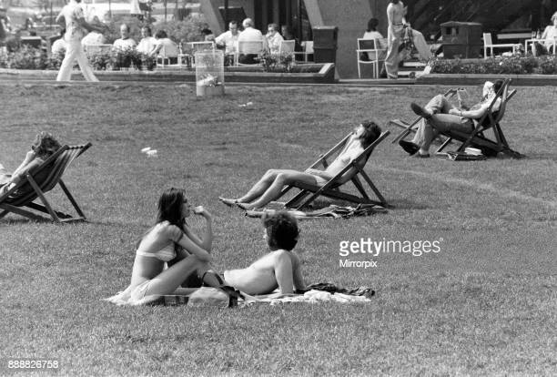 The temperatures rose into the upper 70's again today and crowds flocked to sunbathe and relax in Hyde Park London 7th May 1976