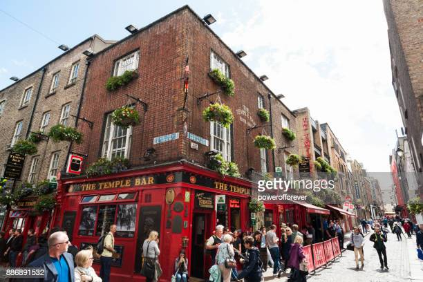 the temple bar pub at temple bar district in dublin, ireland - temple bar dublin stock photos and pictures