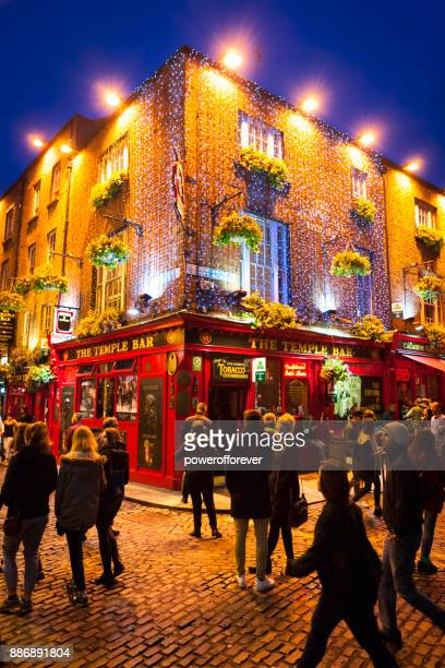 the temple bar pub at temple bar district in dublin, ireland - irish pub stock photos and pictures