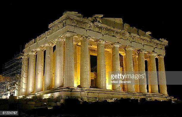 The temple of Parthenon is pictured lit up at night atop the ancient Acropolis of Athens on August 26 during the 2004 Olympic Games in Athens Greece