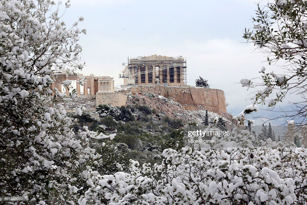 The Temple of Parthenon on the ancient Acropolis hill is seen following a rare snowfall on January 10, 2017 in Athens, Greece. Schools in Athens remained closed on Tuesday and the rare snowfall caused traffic disruptions.