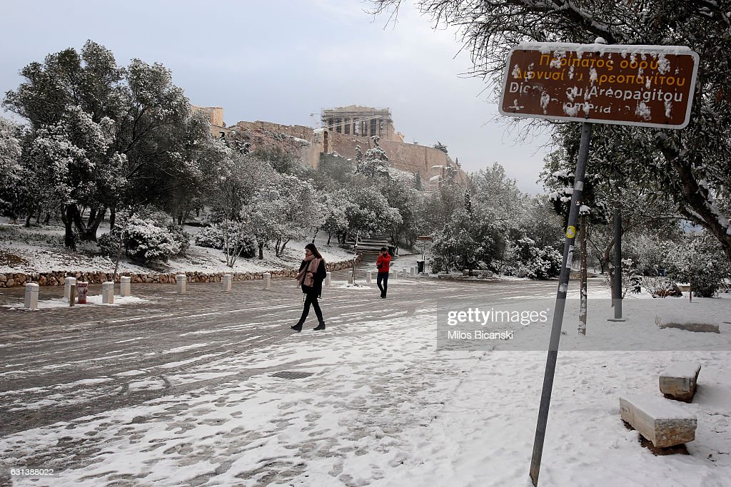 The Temple of Parthenon on the ancient Acropolis hill is seen following a rare snowfall on January 10, 2017 in Athens, Greece. Schools in Athens remained closed on Tuesday and the rare snowfall caused traffic disruptions in the city centre.