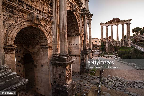 The Temple of Saturn and Arch of Septimius Severus at dusk in the Roman Forum, Rome, Italy