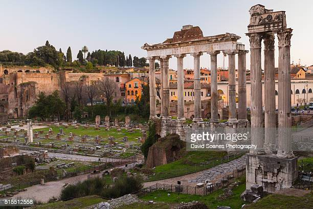 The Temple of Saturn and Temple of Castor and Pollux at dusk in the Roman Forum, Rome, Italy