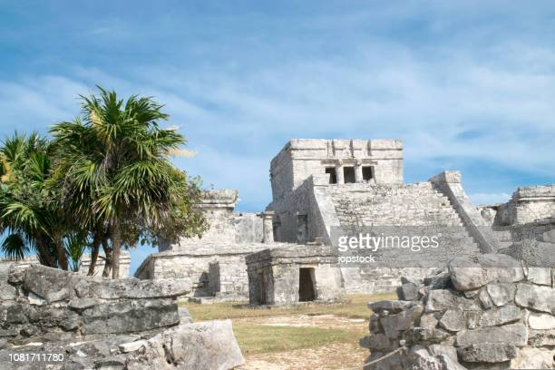 the temple of the god of wind and el castillo (the castle) in tulum ruins, mexico - mexican god stock pictures, royalty-free photos & images