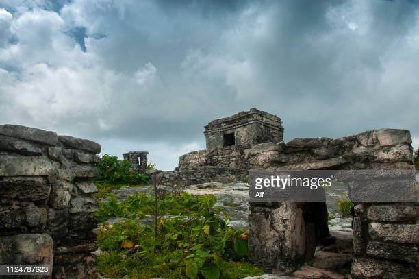 the temple of the wind god in tulum, quintana roo, mexico - mexican god stock pictures, royalty-free photos & images
