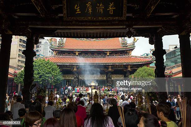 CONTENT] The Temple worships a mixture of Buddhist Taoist and folk deities Mengjia Longshan Temple Taipei Taiwan