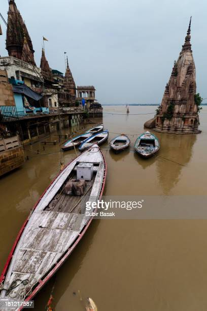 CONTENT] The temples in Monikornika Ghat area is under water on 2nd September 2013 as Ganga is flowing above danger mark in Varanasi and is on...
