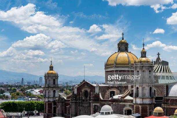 the templo expiatorio de cristo rey antigua basilica and the basilica of our lady of guadalupe in  mexico city mexico - mexico city stock pictures, royalty-free photos & images