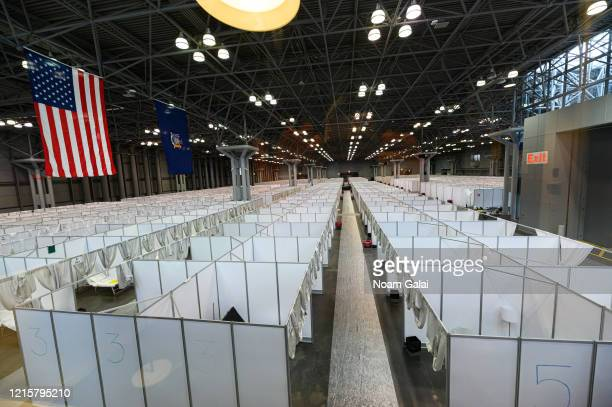 The temporary hospital is readied at the Jacob Javits Convention Center during the Coronavirus pandemic on March 30, 2020 in New York City. The Army...