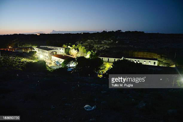 The temporary shelter Center where immigrants are detained after their arrival on the island is seen on October 8 2013 in Lampedusa Italy The search...