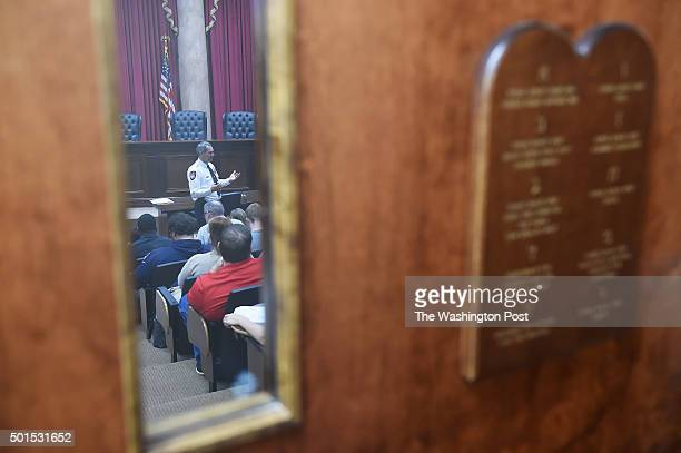 The Ten Commandments are seen on a door as Liberty University Chief of Police Rich Hinkley teaches a gun safety class on the campus of Liberty...
