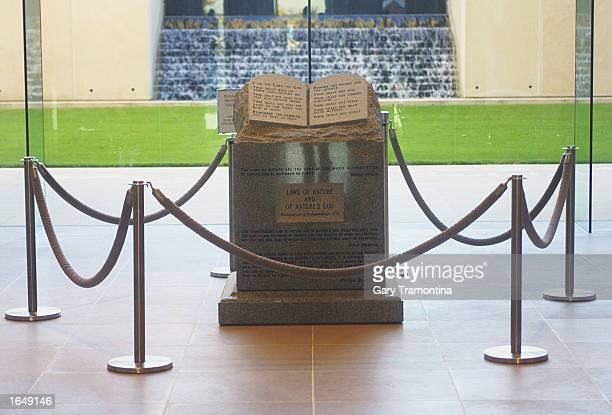 The Ten Commandments memorial rests in the lobby of the rotunda of the State Judicial Building November 18 2002 in Montgomery Alabama US District...