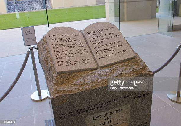 The Ten Commandments memorial rests in the lobby of the rotunda of the State Judicial Building November 18 2002 in Montgomery Alabama Protesters plan...