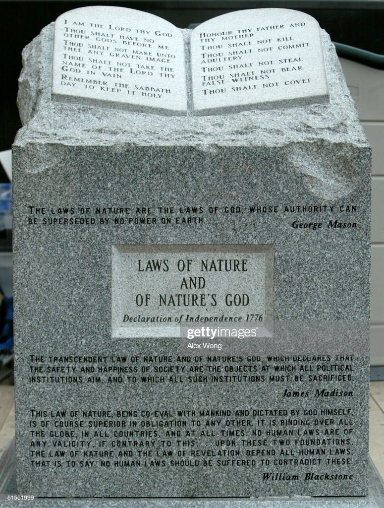 The Ten Commandments monument that was removed from the Alabama Judicial Building is on display during the 'America for Jesus' rally October 22, 2004 at the National Mall in Washington, DC. Although the U.S. Constitution prohibits an official state religion, references to God appear on American money, the U.S. Congress starts its daily session with a prayer, and the same U.S. Supreme Court that has consistently struck down organized prayer in public schools as unconstitutional opens its public sessions by asking for the blessings of God. The Supreme Court will soon use cases from Kentucky and Texas to consider the constitutionality of the Ten Commandments displays on government property, addressing a church-state issue that has ignited controversy around the country.