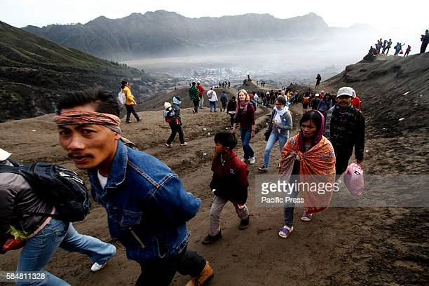 The Tengger tribe communities and tourists climb Bromo crater when Yadnya Kasada ceremony was held in July 2016