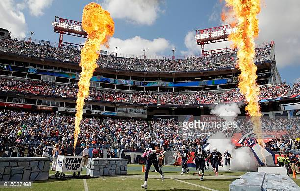 The Tennesse Titans take the field before the start of the game against the Cleveland Browns at Nissan Stadium on October 16 2016 in Nashville...