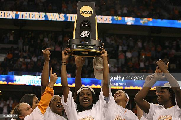 The Tennessee Lady Volunteers celebrate with the championship trophy after their 6448 win against the Stanford Cardinal during the National...