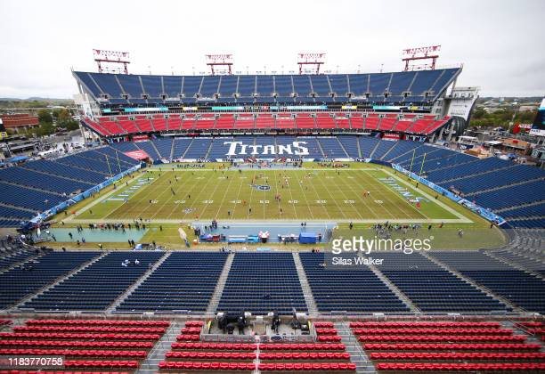 The Tennessee Titans and Tampa Bay Buccaneers warm up on the field before the game at Nissan Stadium on October 27, 2019 in Nashville, Tennessee.
