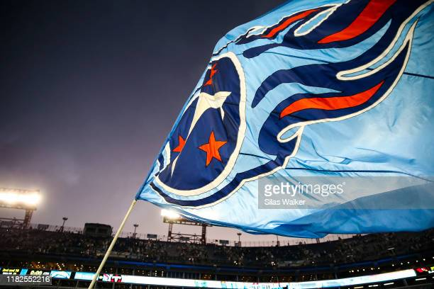 The Tennessee Titans flag is waved on the field after the game against the Los Angeles Chargers at Nissan Stadium on October 20, 2019 in Nashville,...