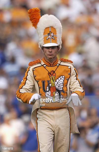 The Tennessee Volunteers marching band drum major conducts the band before the NCAA football game against the Middle Tennessee State Blue Raiders at...