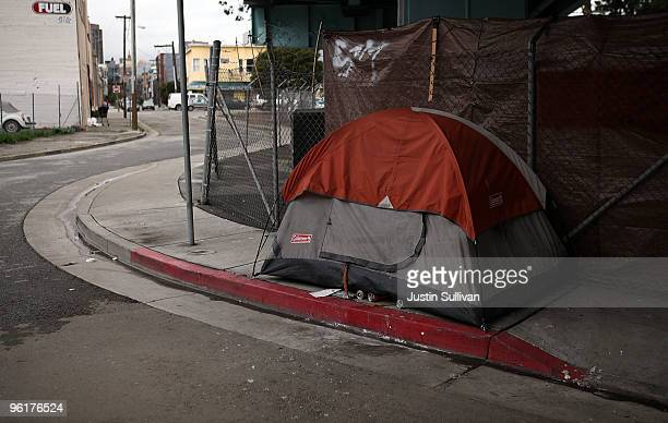 The tent of a homeless man is pitched on the sidewalk under a freeway overpass January 25 2010 in San Francisco California San Francisco Mayor Gavin...