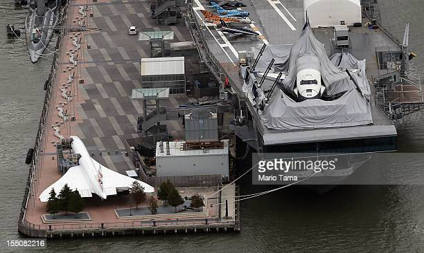 The tent pavilion is collapsed over the Space Shuttle Challenger at the Intrepid Air Sea and Space Museum after Superstorm Sandy on October 31 2012...