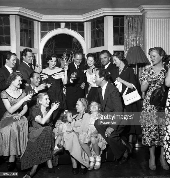 1949 The tenth anniversary party of actor Denis Price's wedding showing Denis Price his wife and two daughters with guests LR Sheila Sim Richard...