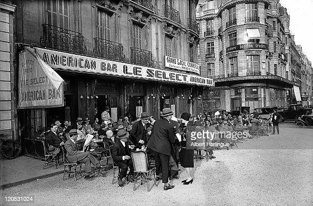 The terrace of the American Bar 'Le Select' on the Avenue des ChampsElysees at the corner of the Rue de Berri Paris about 19261927