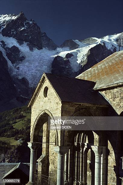 The Terrasses church in the national park of Ecrins Alps France The Terrasses village near La Grave the church porch with the La Meije mountain in...