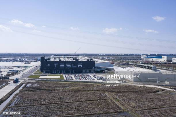 The Tesla Inc Gigafactory stands in this aerial photograph taken in Shanghai China on Monday Feb 17 2020 Tesla has fully resumed deliveries of its...
