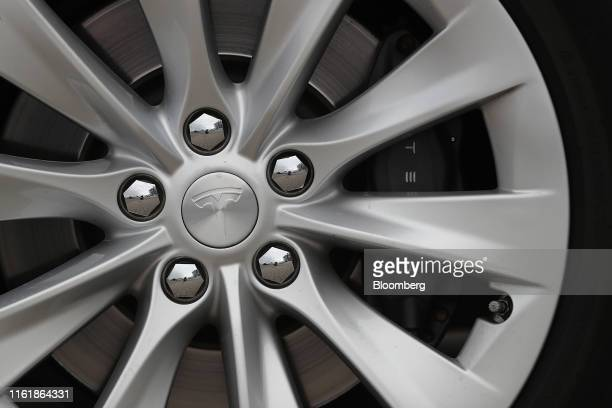 The Tesla Inc. Logo sits on the wheel hub of a Tesla Model S electric automobile at the Nextmove headquarters in Leipzig, Germany, on Thursday, Aug....