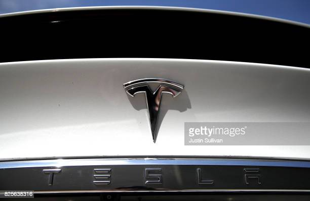 The Tesla logo appears on a brand new Tesla Model S on August 2 2017 in Corte Madera California Tesla will report secondquarter earnings today after...